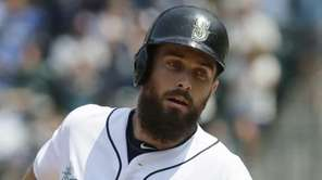 The Seattle Mariners' Dustin Ackley rounds the bases