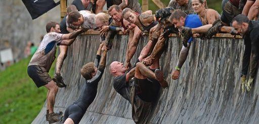 Participants take part in the Tough Mudder endurance