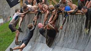 Participants take part in the Tough Mudder endurance