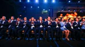 Members of the Chinese delegation clap hands during
