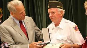 Rep. Steve Israel (D-Huntington) hands the Purple Heart