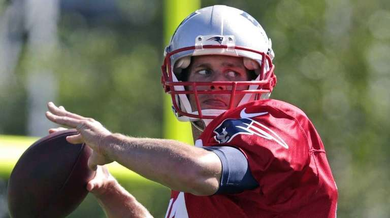 New England Patriots quarterback Tom Brady throws during