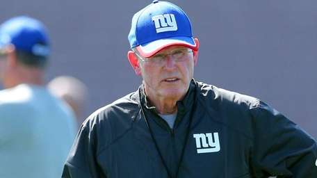 Giants head coach Tom Coughlin watches drills during