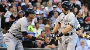Mark Teixeira of the New York Yankees, right,