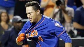 New York Mets shortstop Wilmer Flores hits a