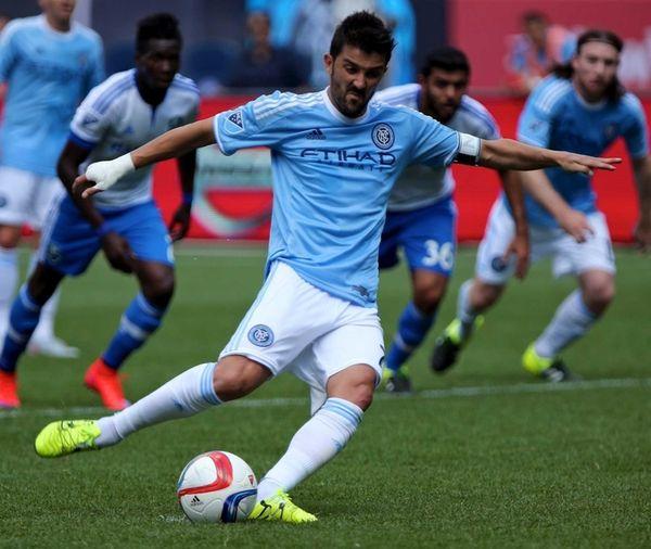 NYCFC forward David Villa shoots and scores on