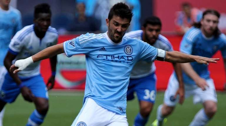 NYCFC forward David Villa shoots and scores on