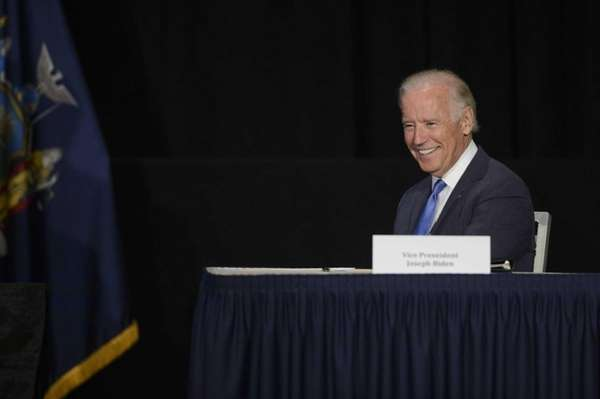 Vice President Joe Biden reacts as Gov. Andrew