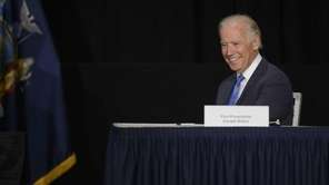 Vice President Joe Biden reacts as Gov. Andrew