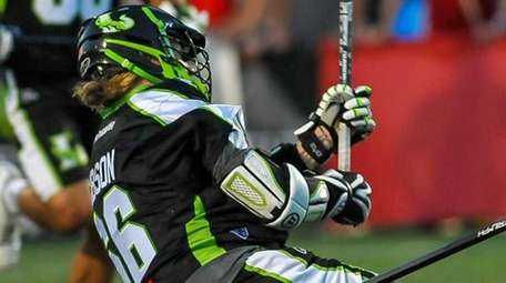 New York Lizards' Matt Gibson, left, heads to