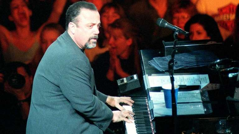 Billy Joel appears in concert on opening night