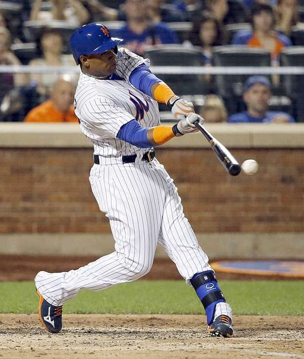 New York Mets leftfielder Yoenis Cespedes connects for