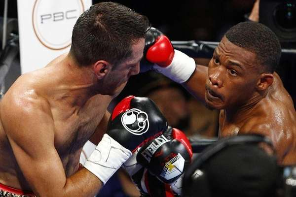 Middleweight Danny Jacobs, right, swings at middleweight Sergio