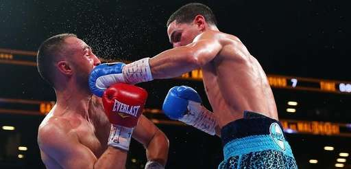 Danny Garcia, right, exchanges punches with Paulie Malignaggi