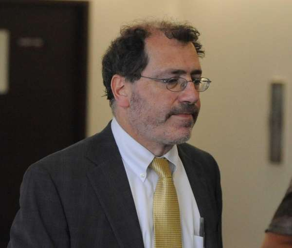 Suffolk County Chief Medical Examiner Michael Caplan walks