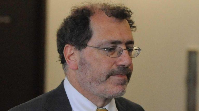 Suffolk County Chief Medical Examiner Michael Caplan walks