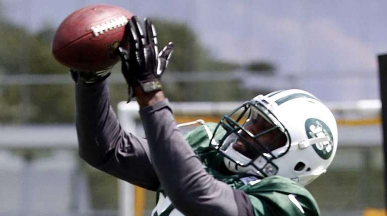 Jets cornerback Darrelle Revis intercepts a pass during