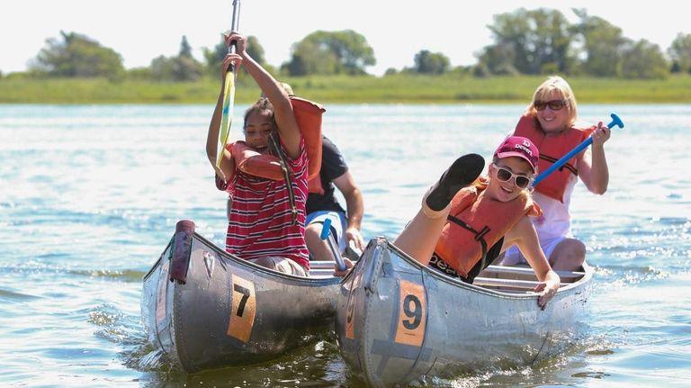 A canoe paddled by Ezekiel Johnson of Freeport,