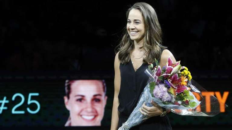 Becky Hammon smiles during a ceremony inducting her