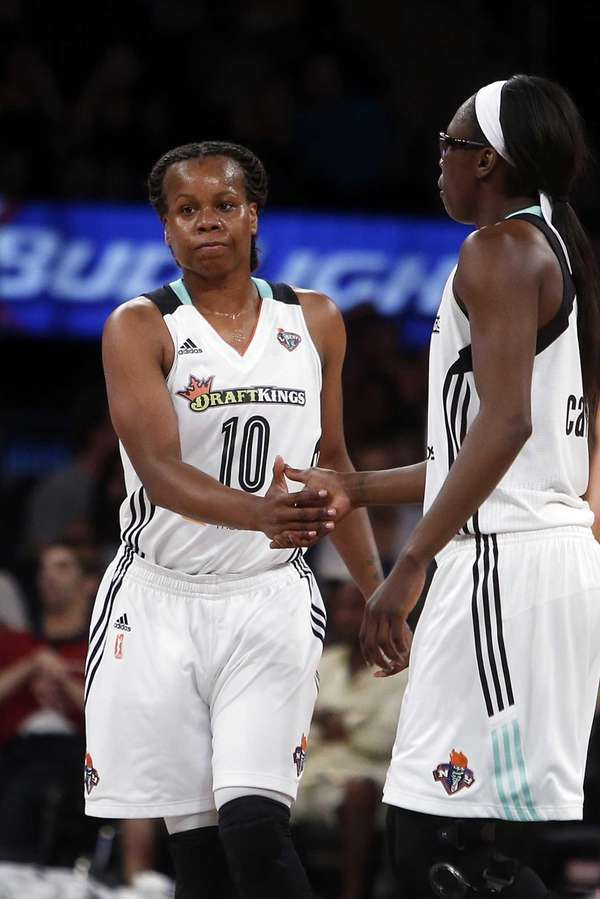 The Liberty's Epiphanny Prince is congratulated by teammate