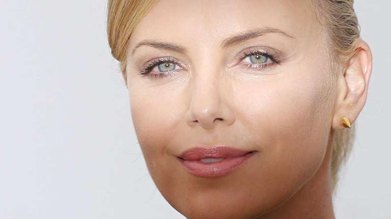 South-African actress Charlize Theron as she poses during