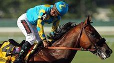 Victor Espinoza rides atop American Pharoah #4 reacts