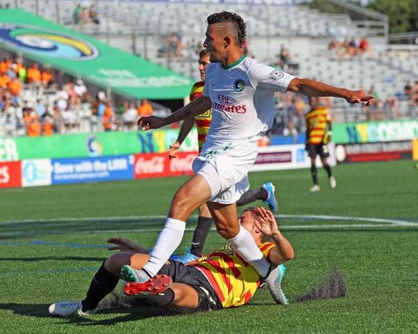 The Cosmos' Leo Fernandes #22 watches as his