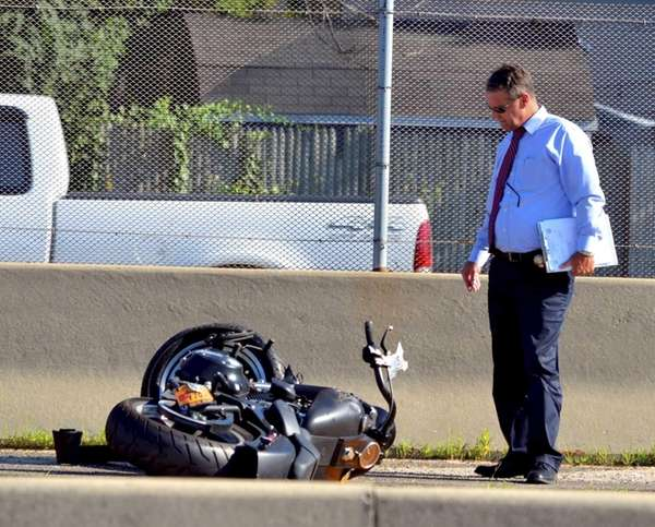 A SUV collided with a motorcycle on the