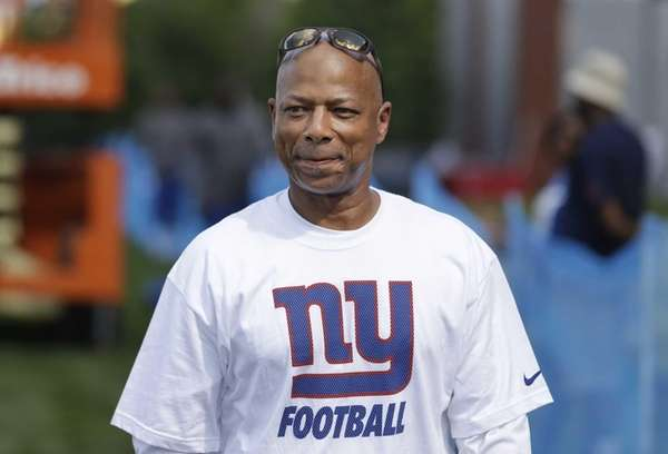 New York Giants general manager Jerry Reese walks