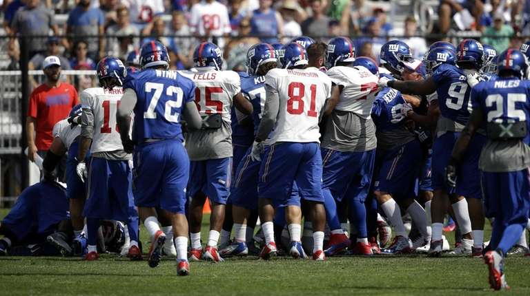 New York Giants players scuffle during practice at