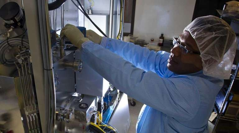 Electrical engineering manager Ramon Garcia simulates working on