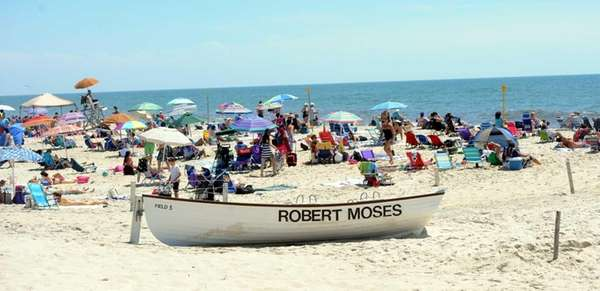 Beachgoers enjoy a sunny and warm day at
