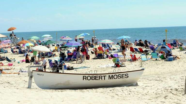 Beachgoers Enjoy A Sunny And Warm Day At Robert Moses Beach Field 5 Monday Afternoon In West