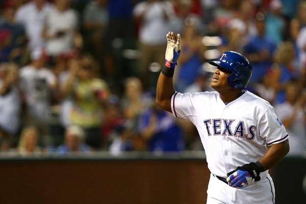 Adrian Beltre #29 of the Texas Rangers waves