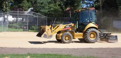 Town of Smithtown workers use a piece of