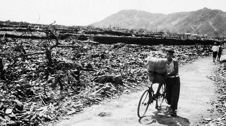 A man pushes a loaded bicycle down a
