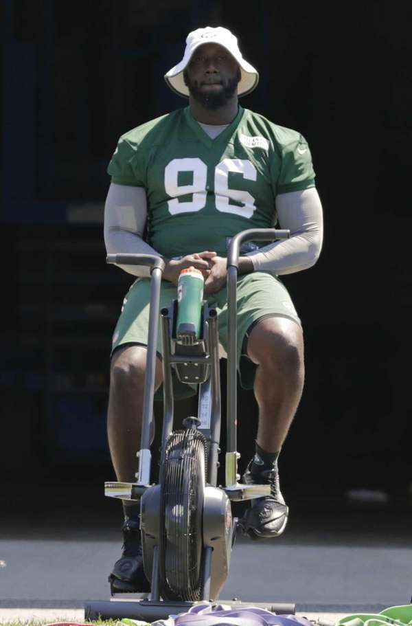 The New York Jets' Muhammad Wilkerson rides a