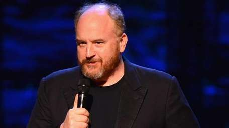Louis C.K. performs on stage at Comedy Central