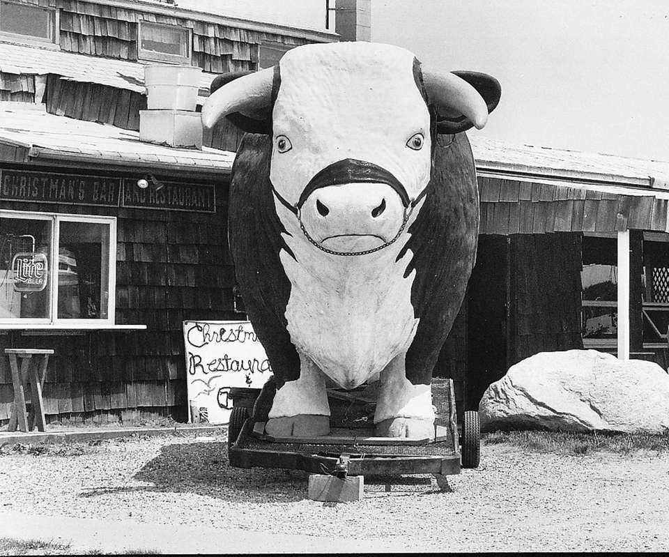 A 25-foot bull stands in front of Christman's