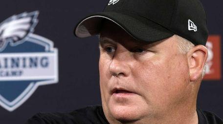 Philadelphia Eagles head coach Chip Kelly speaks with