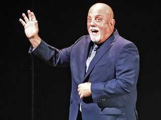 Billy Joel performs before a sellout crowd at