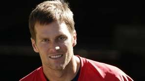 New England Patriots quarterback Tom Brady heads to