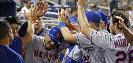 The New York Mets' Juan Lagares celebrates with