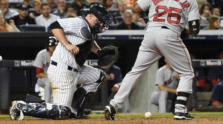 New York Yankees catcher Brian McCann bobbles a