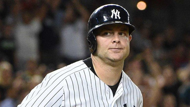 New York Yankees catcher Brian McCann runs on
