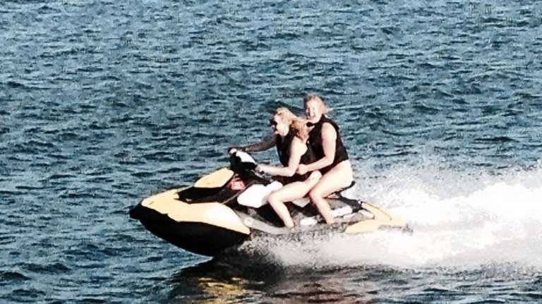 Actresses Jennifer Lawrence, front, and Amy Schumer ride
