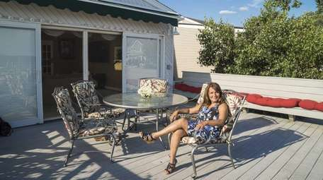 Seller Jeannette Le Duc on the outdoor deck