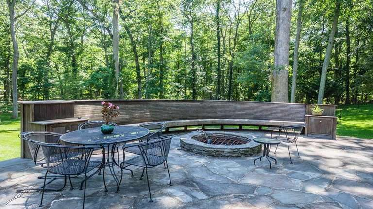 A firepit at this Lloyd Neck house, becomes