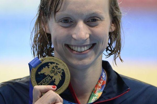 U.S. gold medallist Katie Ledecky poses on the