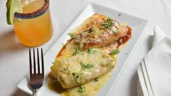 Cornmeal tamales stuffed with chicken, cheese, onions and